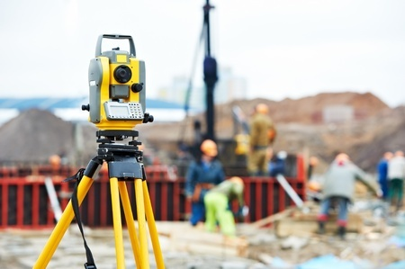 13219944 - surveyor equipment theodolite at construction site